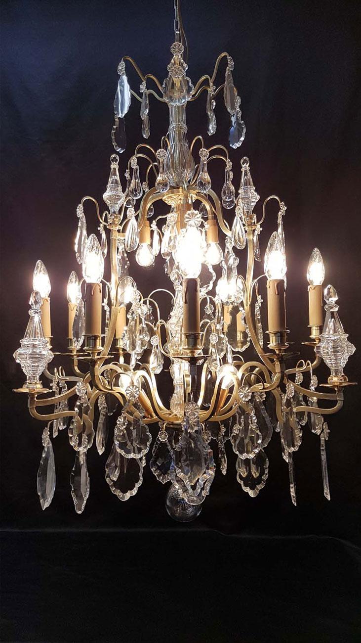 Lustre bronze et cristal 9+6+1 lumières après restauration
